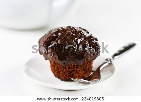 Yummy chocolate cupcake on table, close-up - stock photo