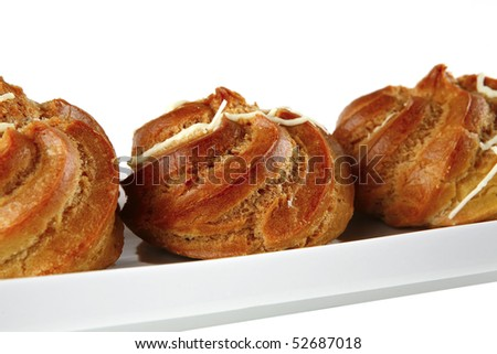 yummy creamy cakes served over white background