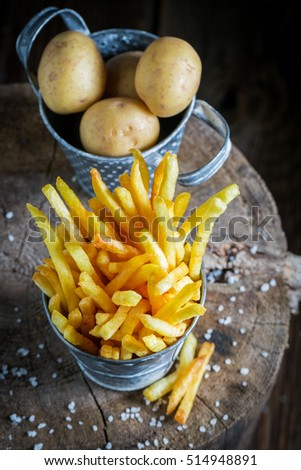 Yummy french fries with salt made of fresh potato