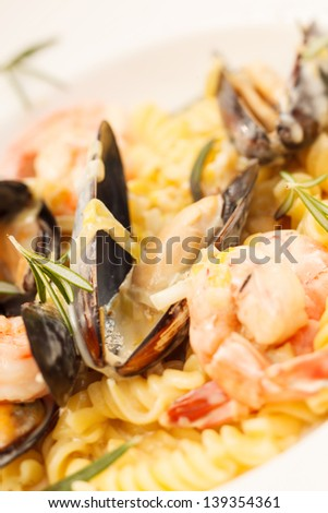 yummy italian pasta with seafood - stock photo