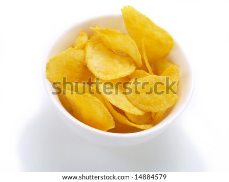 Yummy potato chips in a white bowl - stock photo