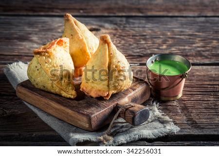 Yummy samosa with dip - stock photo