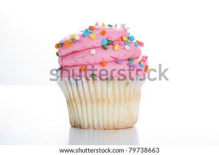 yummy vanilla cupcake on white background - stock photo