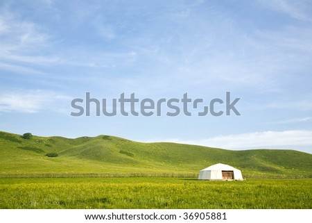 Yurt - Nomad's tent in the grassland - stock photo