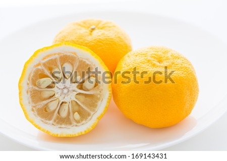 Yuzu citrus fruits on a plate - stock photo
