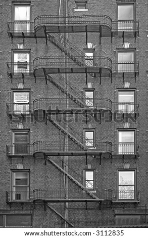z shaped fire escape leading down back of building - stock photo