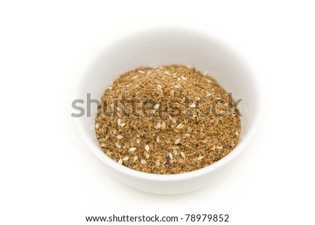 Za'atar is a Middle Eastern spice mixture, a blend of herbs, toasted sesame seeds and salt. Frequently used as a spread on bread.