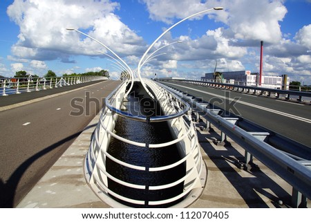 ZAANDAM, HOLLAND - JULY 30:Juliana Bridge (UNESCO). The extra wide deck for walkers, with its curved lamp posts, gives the pedestrian zone a boulevard ambience; July 30, 2012 in Zaandam, Holland.