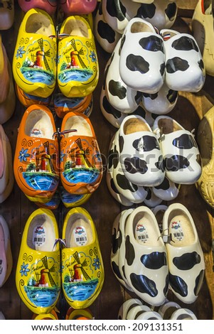 ZAANDAM, NETHERLANDS - JUNE 17, 2014: Beautifully painted Dutch traditional wooden shoes (clogs) - klompens - symbol of Netherlands in Zaanse Schans (museum village). - stock photo