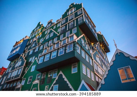 ZAANDAM, NETHERLANDS - MARCH 18, 2016: Inntel hotel at twilight time. Opened in 2009, design attracts guests by incorporating traditional architecture of Zaan region on 18 March in Zaandam, Holland.