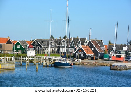 ZAANSE SCHANS NETHERLAND 10 01 2015: Houses in Zaanse Schans is a neighbourhood of Zaandam in the municipality of Zaanstad in the Netherlands. It has a collection of well-preserved historic windmills  - stock photo