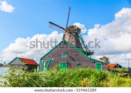 ZAANSE SCHANS, NETHERLANDS - SEPTEMBER 02, 2015: windmills at Zaanse Schans. It is a museum village. A collection of historic windmills and houses from the region were moved to the area starting 1961 - stock photo