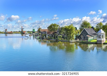 Zaanse Schans. Picturesque view of a Dutch village with old windmills located at the river. - stock photo