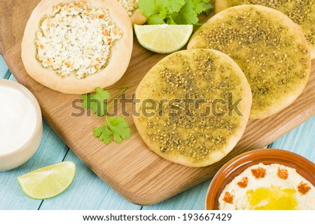 Zaatar & Cheese Manakish - Flatbreads topped with zaatar and olive oil and cheese. Traditional Arab food. - stock photo