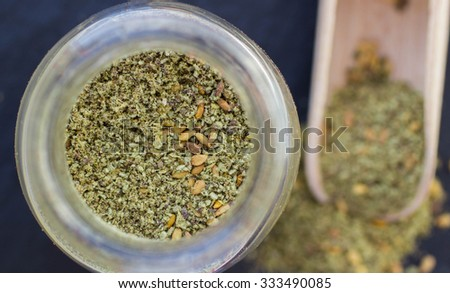 Zaatar -  middle Eastern  mixture of spices and seasonings for meat, poultry and salads. Selective focus - stock photo