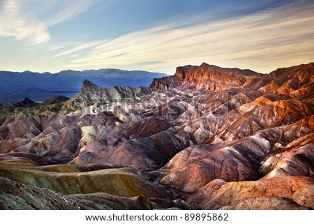 Zabriski Point Manly Beacon Mudstones form Badlands  Death Valley National Park California - stock photo
