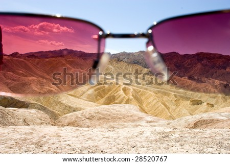 Zabriskie point, Death Valley, seen through sunglasses - stock photo
