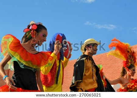 Zacatecas, Mexico, 03 August 2013: A dacne group from Mexico in very colorful costumes at the 18th Festival Cultural Internacional Zacatecas del Folclor. It is the biggest international folcloric