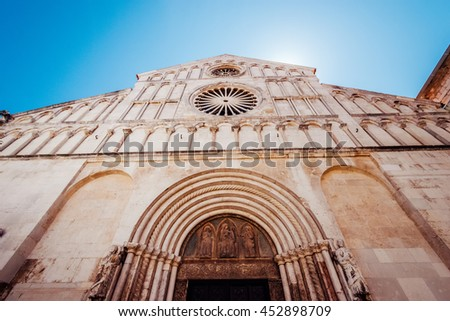 ZADAR, CROATIA - JULY 28, 2015:  Facade and front entrance of the church of St. Anastasia in Zadar, Croatia