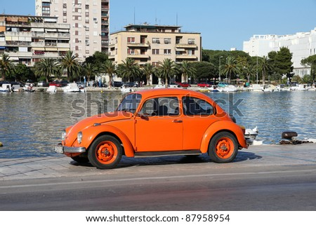 ZADAR, CROATIA - JUNE 22: VW Beetle car on June 22, 2011 in Zadar, Croatia. More 21m of these VWs were manufactured from 1938 to 2003, making it one of most successful cars ever. - stock photo