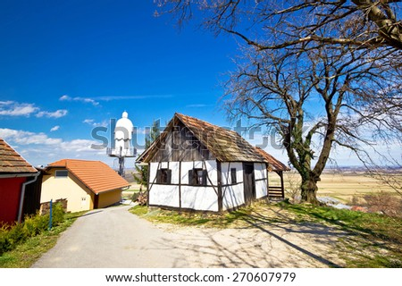 Zagorje hills cottage and st. Vinko statue lookout, Ludbreg, Croatia - stock photo