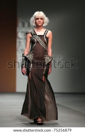 ZAGREB, CROATIA - APRIL 2: Fashion model wears clothes made by Matija Vuica in 'Croaporter' show, April 2, 2011 in Zagreb, Croatia. - stock photo