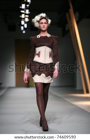 ZAGREB, CROATIA - APRIL 1: Fashion model wears clothes made by Ogi Antunac at the 'Croaporter' show, April 1, 2011 in Zagreb, Croatia. - stock photo