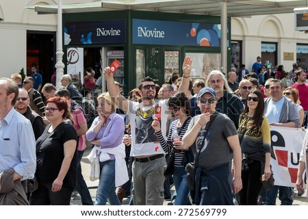 ZAGREB, CROATIA - APRIL 25, 2015: Man holding red card  for banks during a protest against rising interest on loans in Swiss francs in Croatia, Zagreb  - stock photo