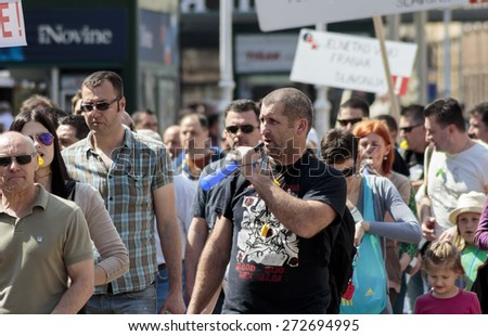 ZAGREB, CROATIA - APRIL 25, 2015: People rally during a protest against rising interest on loans in Swiss francs in Croatia, Zagreb  - stock photo