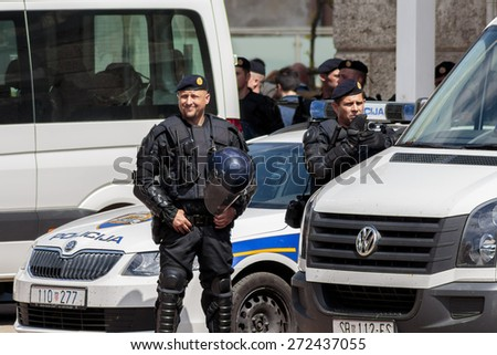ZAGREB, CROATIA - APRIL 25, 2015: Police recording protesters during a protest against rising interest on loans in Swiss francs in Croatia, Zagreb  - stock photo