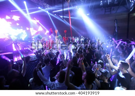 ZAGREB, CROATIA - APRIL 9, 2016 : The audience enjoying the performance of Cirque du Soleil dancers on La Fiesta Stage by Sensation party in Hypo center in Zagreb, Croatia. - stock photo