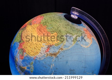 ZAGREB, CROATIA - AUGUST 15, 2014: Light globe with close up China and Japan