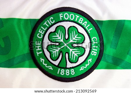 ZAGREB , CROATIA - AUGUST 24 , 2014 :  Logo of Scottish football club Celtic from Glasgow, team official jersey , product shot - stock photo