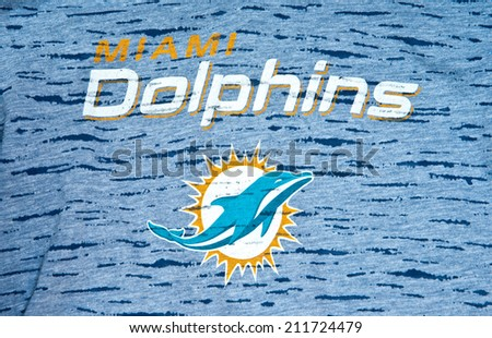 ZAGREB , CROATIA - AUGUST 19 , 2014 :  NFL Miami Dolphins club logo printed on textile equipment ,product shot   - stock photo