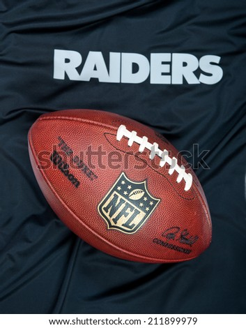 ZAGREB , CROATIA - AUGUST 19 , 2014 :  NFL Oakland Raiders club equipment with NFL official ball, product shot - stock photo