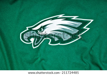 ZAGREB , CROATIA - AUGUST 19 , 2014 :  NFL Philadelphia Eagles club equipment with NFL official ball, product shot  - stock photo