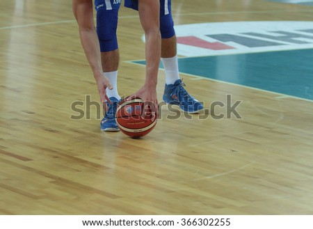 ZAGREB, CROATIA - AUGUST 27, 2015: The match ahead of the EuroBasket 2015 between Israel and Estonia. Player picking up the ball