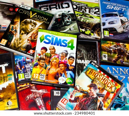 ZAGREB , CROATIA - DECEMBER 1 , 2014 :  Pile of various boxes of PC video games   - stock photo