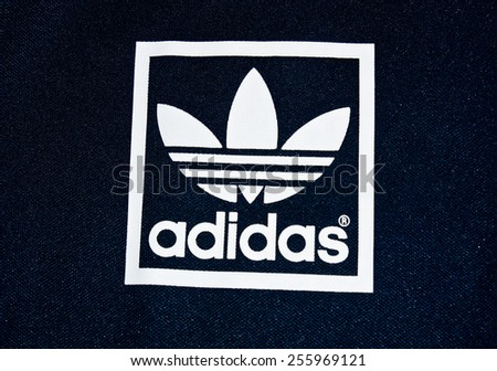 ZAGREB , CROATIA - 19 FEBRUARY 2015 - Close up logo of sport brand Adidas printed on textile , product shot - stock photo