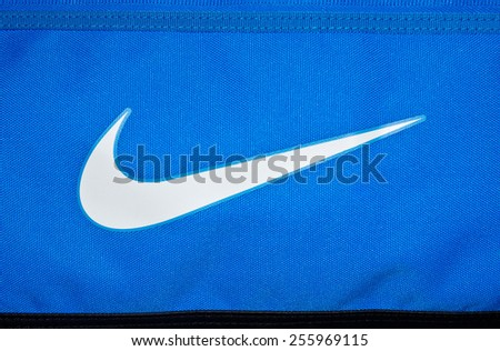 ZAGREB , CROATIA - 19 FEBRUARY 2015 - Close up logo of sport brand NIKE printed on textile , product shot - stock photo