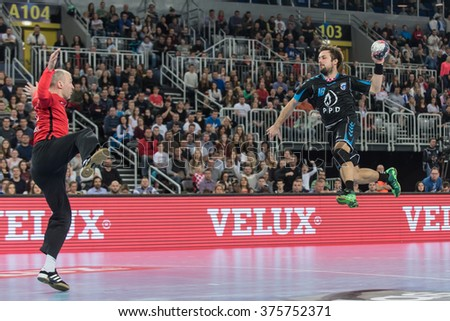 ZAGREB, CROATIA - FEBRUARY 10, 2016- EHF CHAMPIONS LEAGUE -PPD Zagreb VS Paris Saint Germain. Zagreb Zlatko Horvat (18) shoots on goal of Thierry Omeyer (16).