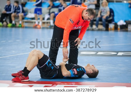 ZAGREB, CROATIA - FEBRUARY 27, 2016: EHF Men's Champions League, Group (A) phase. Match between HC Zagreb PPD and HC Celje. VUJIC Stefan (6) injured on the court.