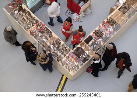 ZAGREB, CROATIA, FEBRUARY 13, 2015: People take a tour and buy chocolate products at the Fair chocolate in Zagreb. on February 13, 2015. - stock photo