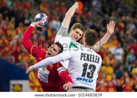 ZAGREB, CROATIA â?? JANUARY 17, 2018: EHF EURO Croatia 2018, Group (C) phase. Germany VS Macedonia. Hendrik PEKELER (13) and Filip MIRKULOVSKI (13)