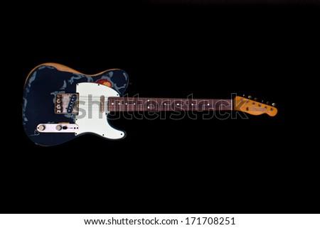 ZAGREB , CROATIA - JANUARY 14 ,2014 : fender telecaster black Joe Strummer style electric guitar on black background , product shot - stock photo