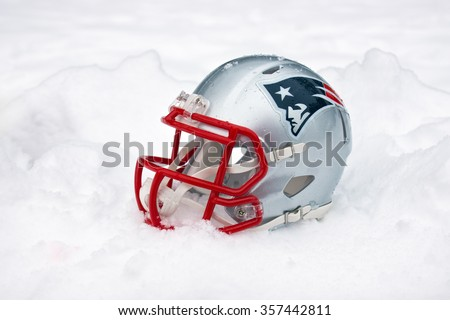 ZAGREB , CROATIA - January 1ST 2016 -  New England Patriots NFL club helmet in the snow and ice , product shot