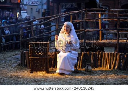 ZAGREB, CROATIA - JANUARY 04, 2014: The religious spirit in the Advent in Zagreb especially can feel the front of the Cathedral, where Community Cenacolo organizes live Christmas nativity scene. - stock photo