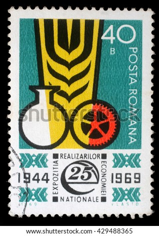 ZAGREB, CROATIA - JULY 18: a stamp printed in Romania shows Ear and industrial symbols, Exhibition Developing National Industry, circa 1969, on July 18, 2012, Zagreb, Croatia - stock photo