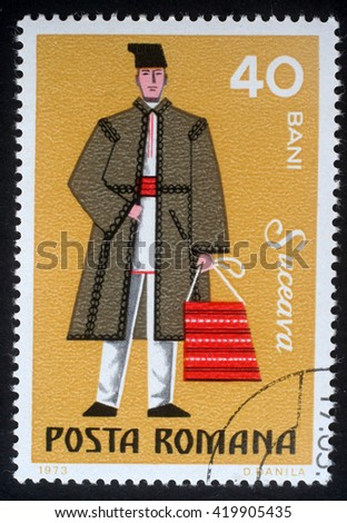 ZAGREB, CROATIA - JULY 18: A stamp printed in the Romania, shows the traditional dress of men in the region Suceava, circa 1973, on July 18, 2012, Zagreb, Croatia - stock photo