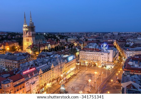 ZAGREB, CROATIA - July 20: Aerial view of Zagreb skyline with the Ban Jelacic Square and the city's Cathedral in Croatia as seen from the observation deck of Neboder tower on July 20, 2015. - stock photo